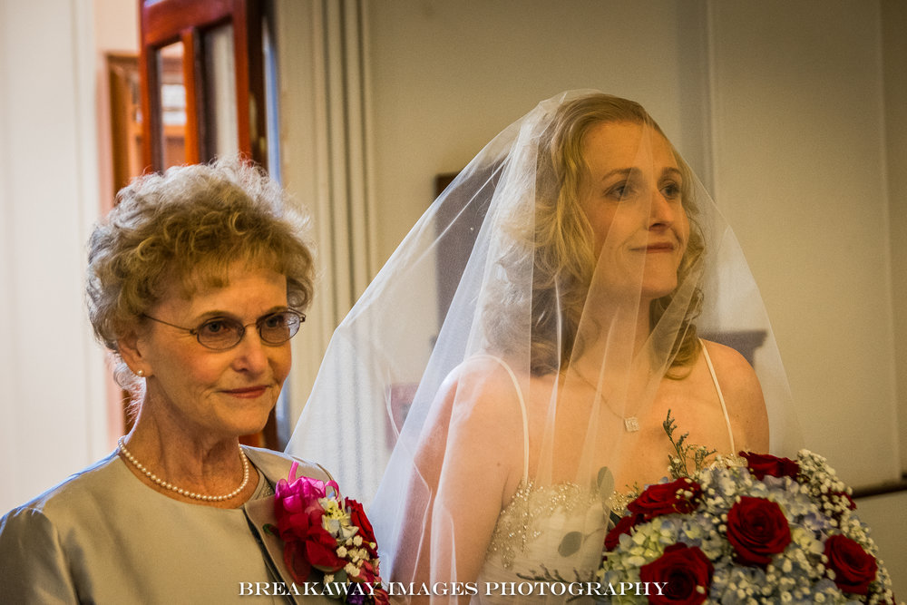 Kim's mom Marge, walking her up the aisle