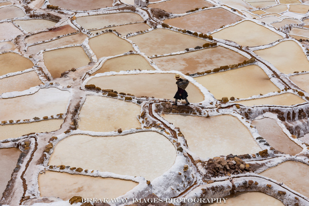 Quechua woman working her claim in the Maras Salt Flats, Peru