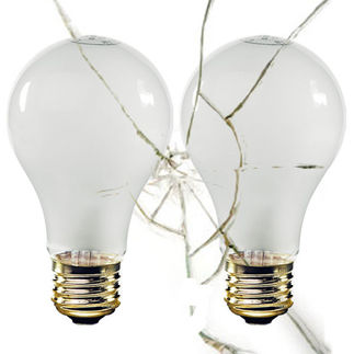 Rough service shatter resistant incandescent light bulb
