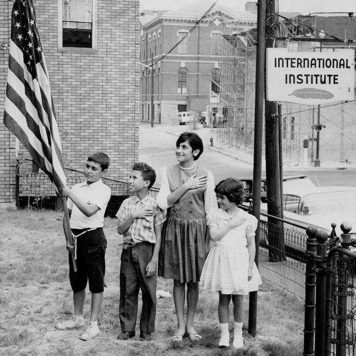 Children pledging allegiance outside the IINE-Lowell site. (1964)