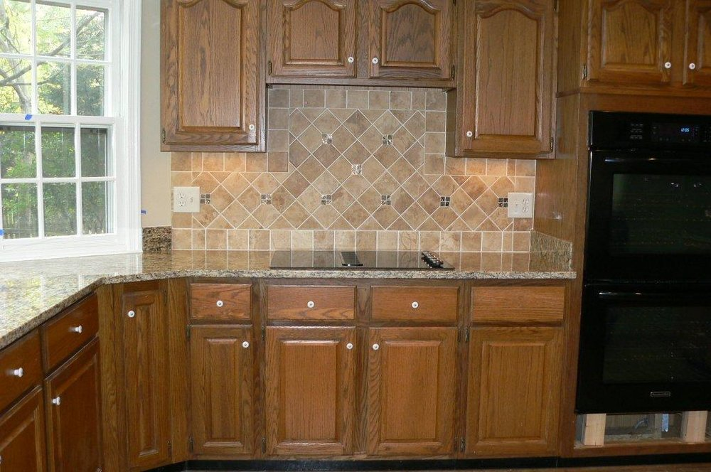 Before Cabinets with New Countertop/Backsplash Tile