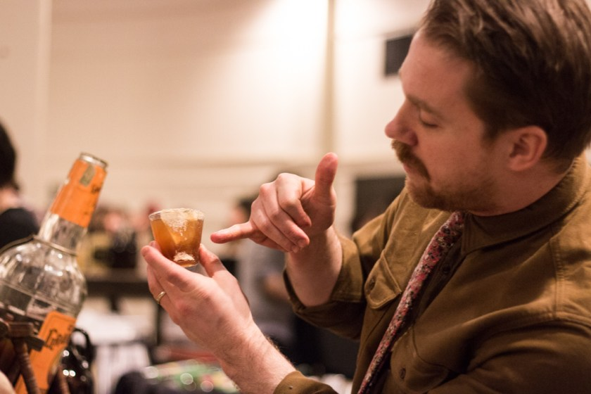 Chad Hauge describes his grand prize winning cocktail, the Stone Bridge. (Photo courtesy of Lakeshore Beverage.)
