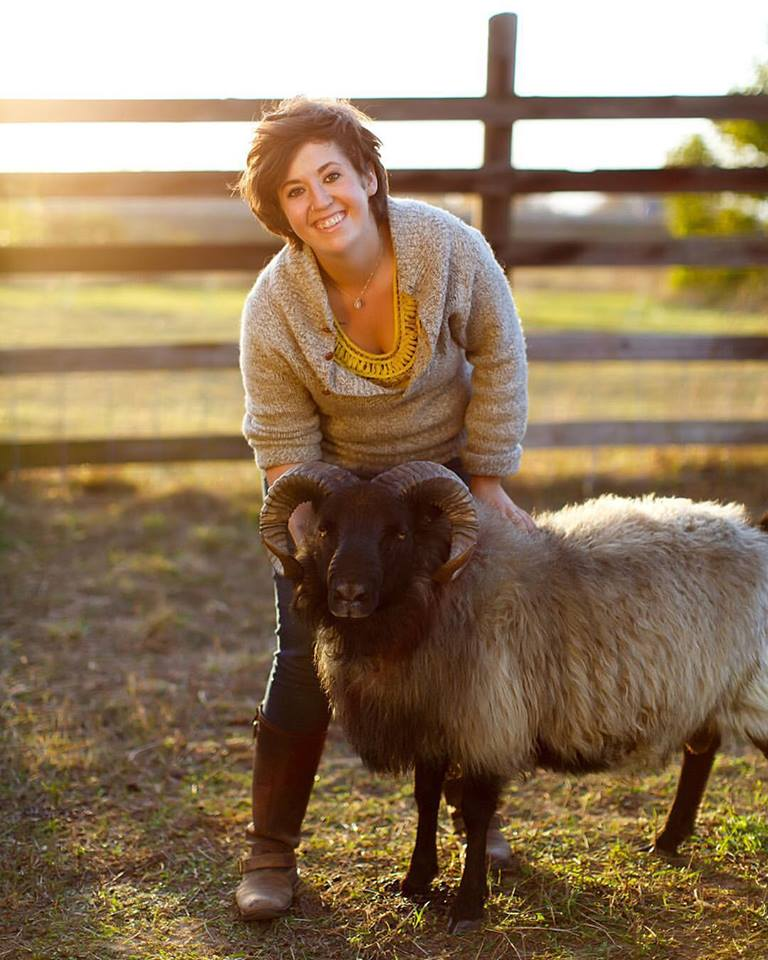 Johanna Bystrom, Virtue Cider events coordinator and owner/founder of garlic+sheep with one of her rams.