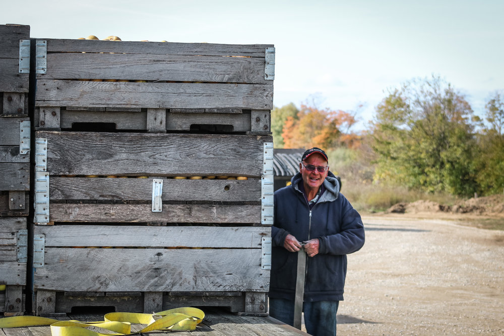 Ed Baushke of Heritage Orchards removes the straps from his apple crates.