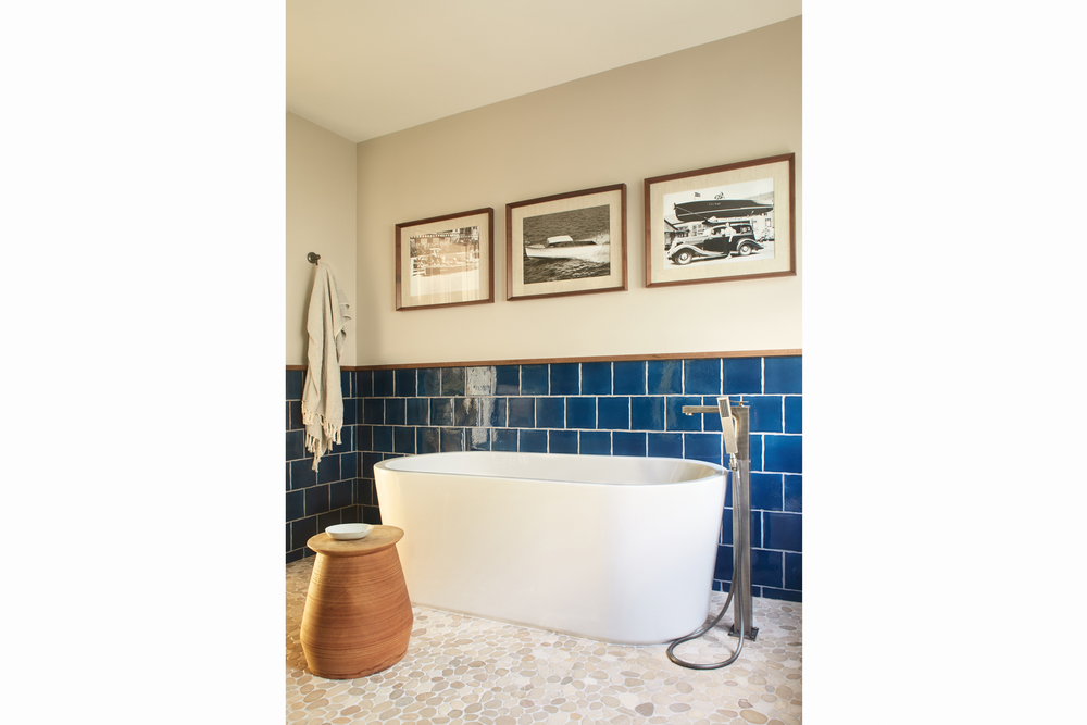newport beach interior designer brittany stiles blue nautical master bathroom blue tile modern tub.jpg