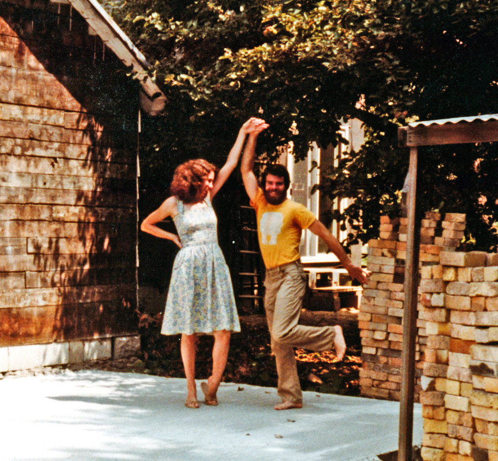 Paula and I celebrating our completion of the cement foundation for our first kiln in 1982