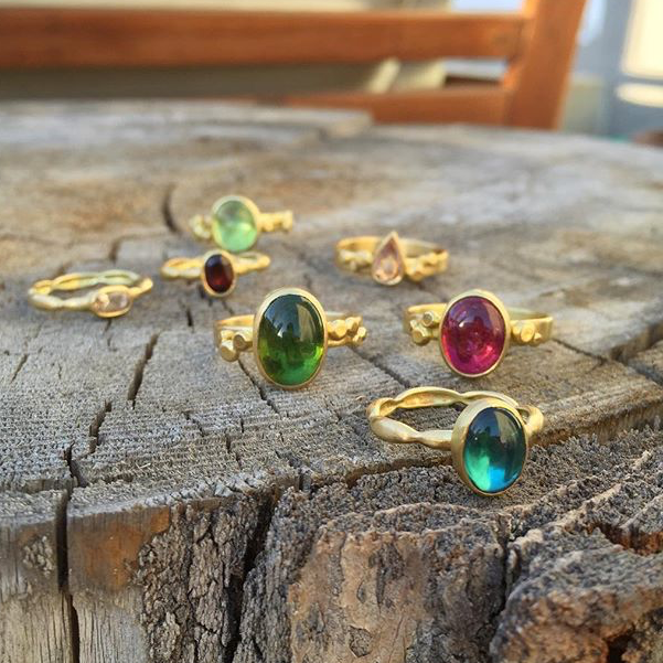 A trio of tourmaline cabochons lead this luscious group of statement rings.