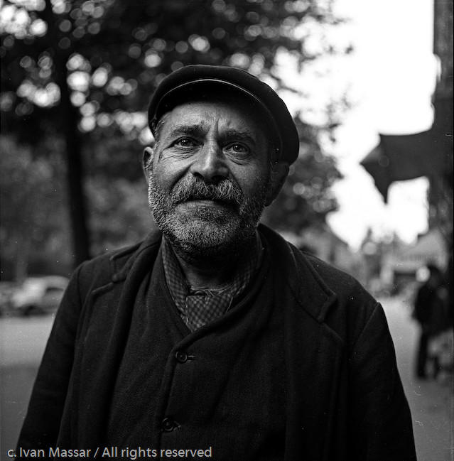 Street portrait along the Seine.