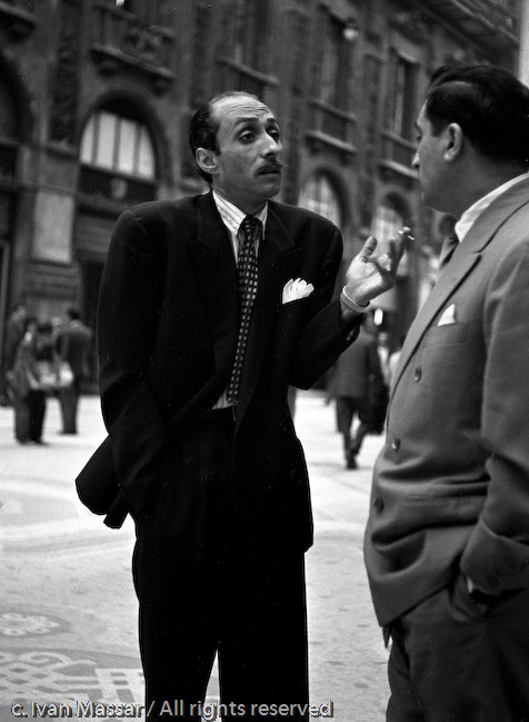 Animated conversation. Milan, Italy, 1950.