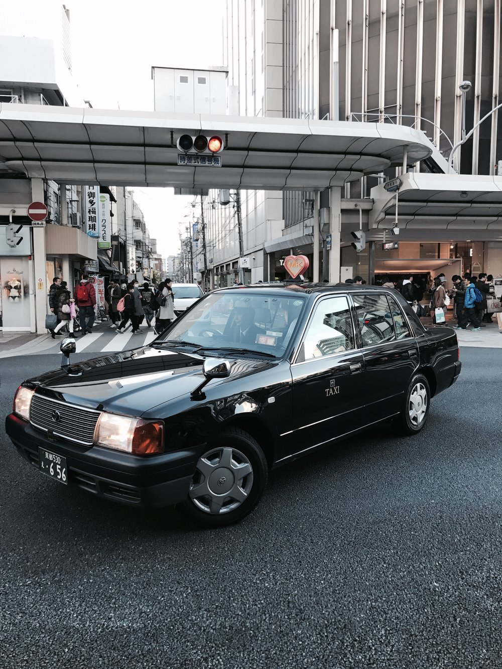 The taxi cabs in Japan are so kawaii!  (Kyoto, Japan)