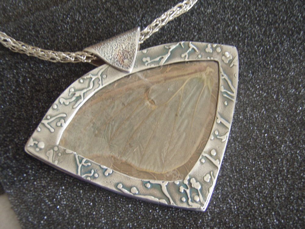 Luna moth pendant:  Fine silver frame with luna moth wing under mica.
