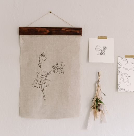 Scipt and Vine - Snapdragon Flowers Wall Hanging - Raw cut linen wall hanging featuring an original illustration of snapdragon flowers. This floral art piece includes a wood frame.