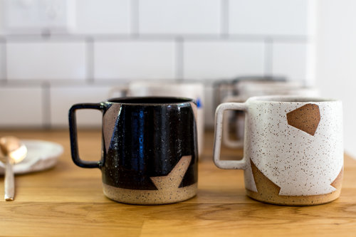 Margaret and Beau - Geo Mug - I know, a mug can be kind of a boring gift. But NOT this mug!Handmade ceramics + completely unique design = win.I adore the geometric shapes and sharp clean lines against the rough texture of the ceramic.