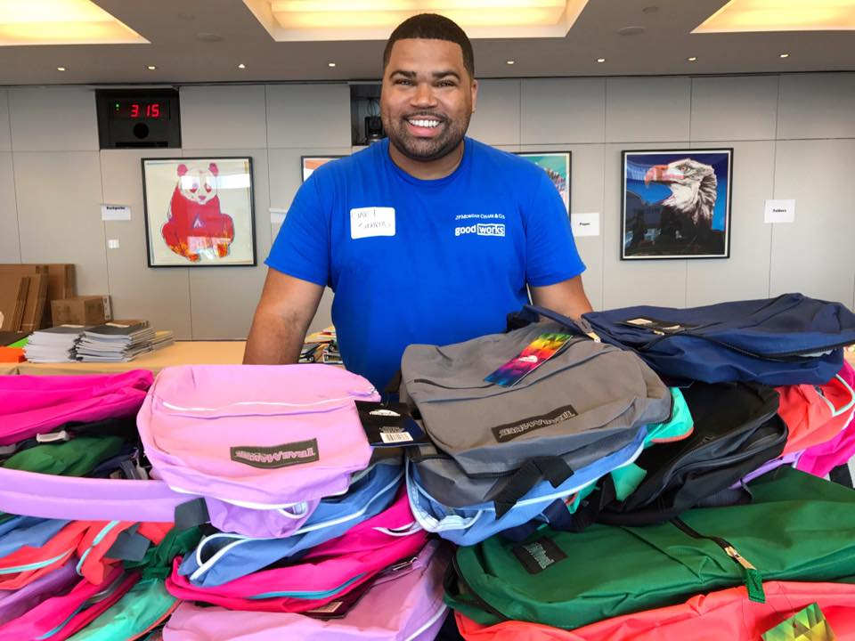 Gary Bushrod participated in the effort to pack over 6,000 backpacks for children in need all over the world.