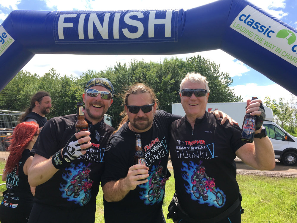 Chris Maric with Iron Maiden Managers, Dave Shack & Rod Smallwood at the finish line in 2017