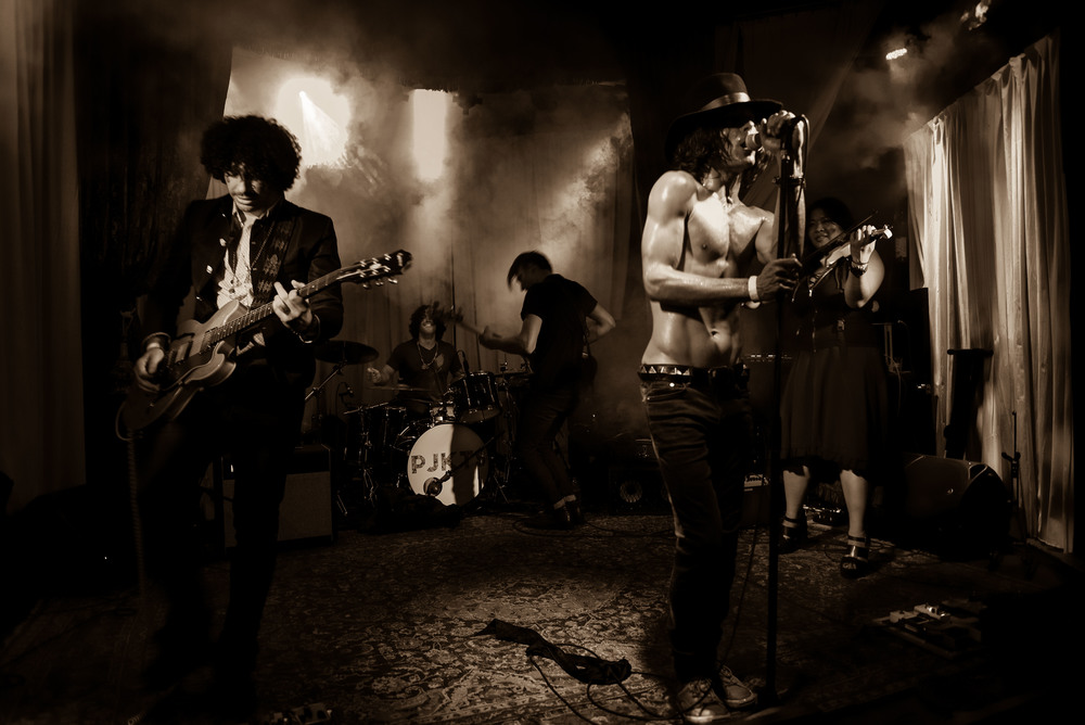 Photo by Alex Huggan. Playing with the band Fire at Club Moscow.