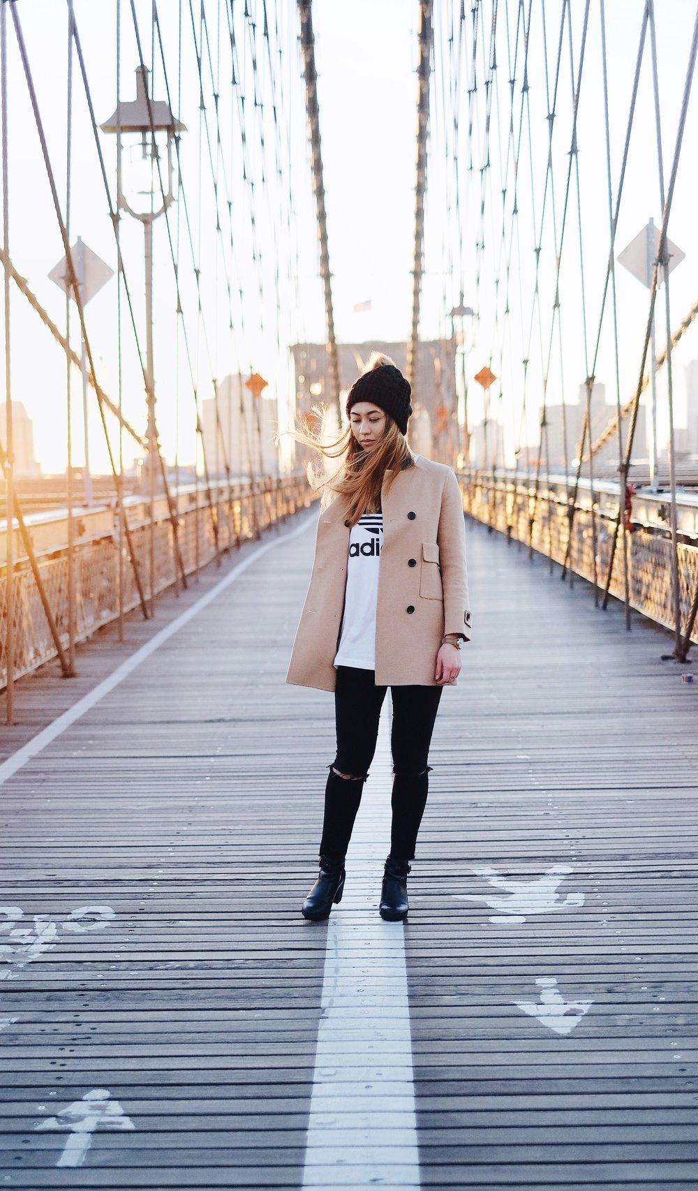 Asian girl on a new york bridge by a social media photographer