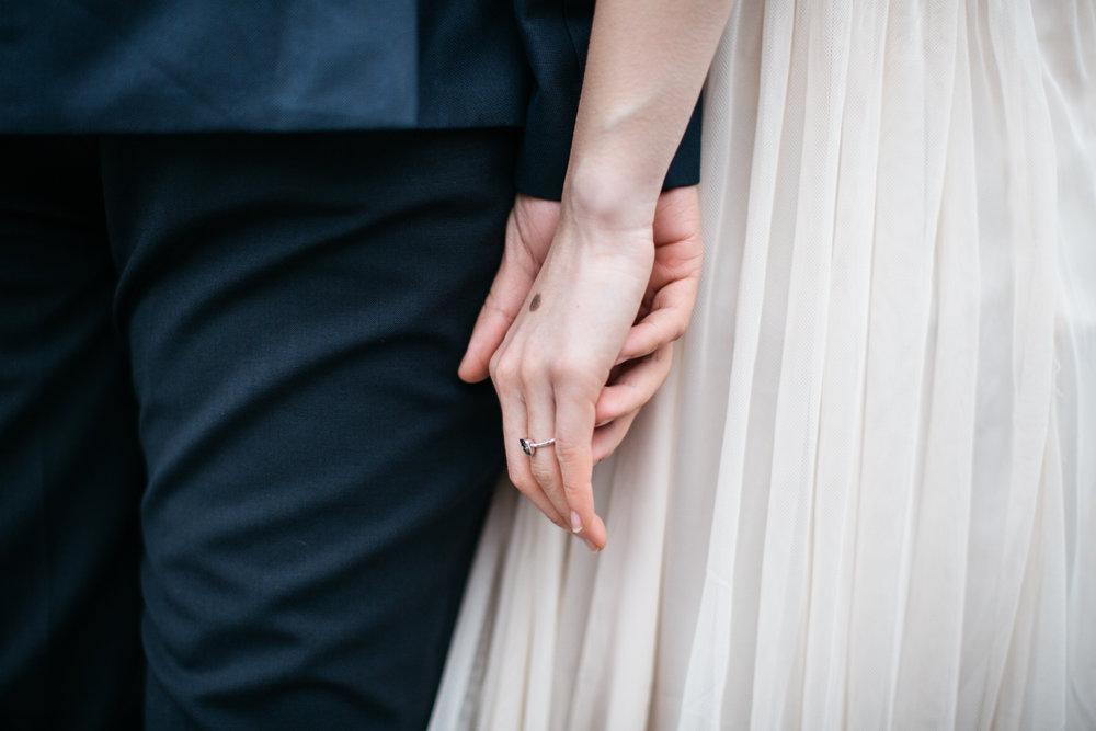 Holding hands wedding photography couple