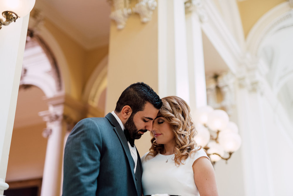 engaged couple touching heads at osgoode hall for toronto wedding