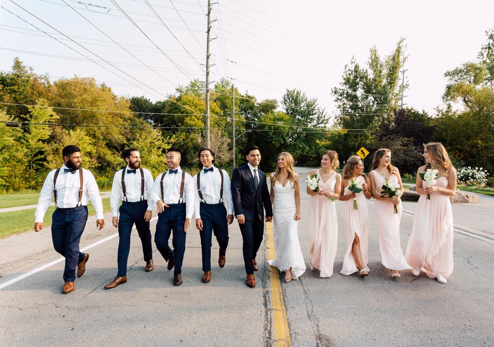 Wedding party in the street at a toronto wedding near madsens house
