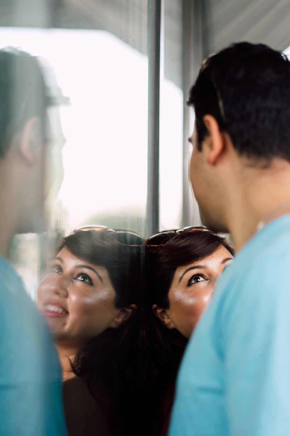 Creative reflective picture of engagement couple in toronto