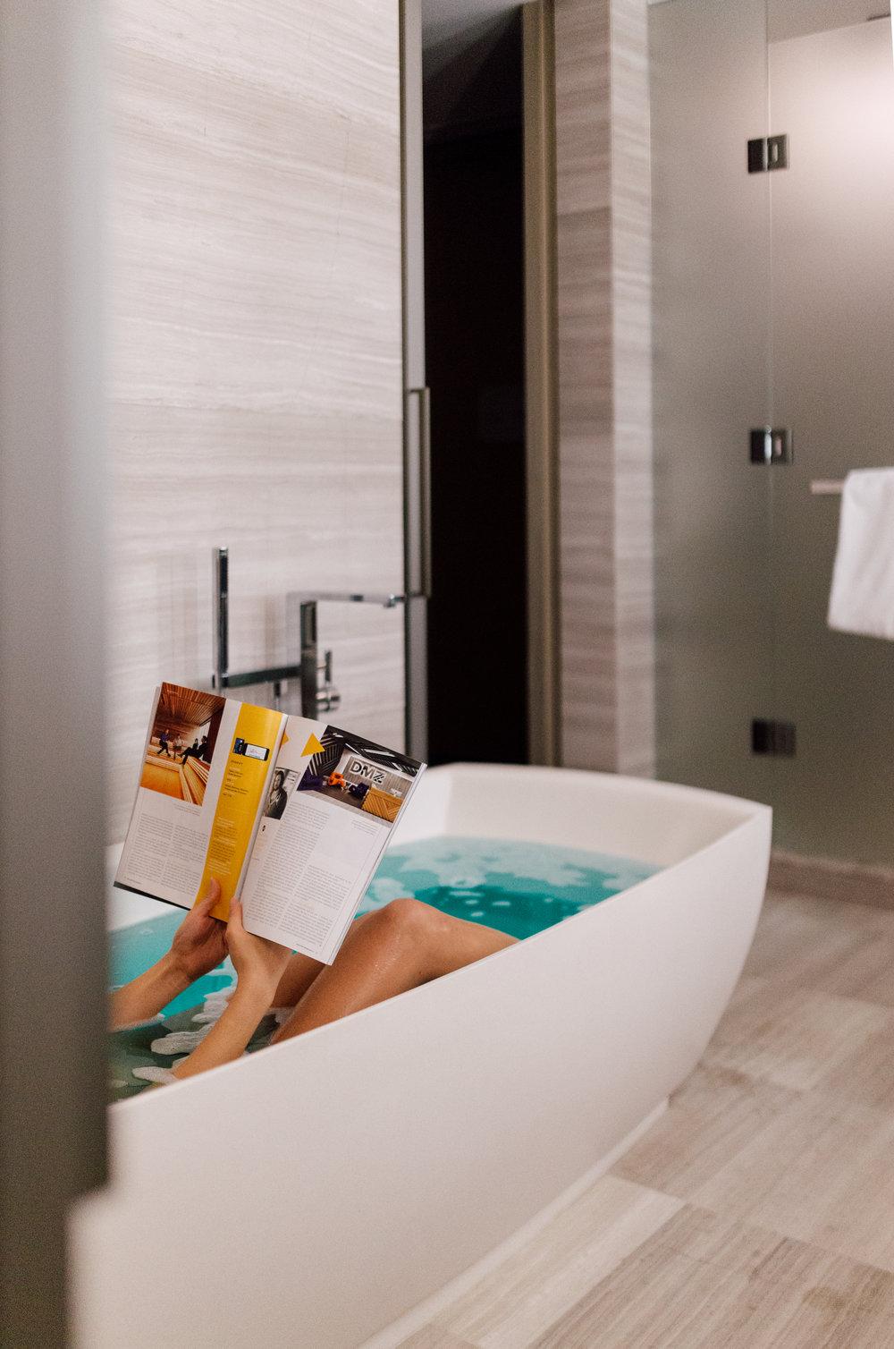 Tan girl in luxury bathtub by a social media photographer