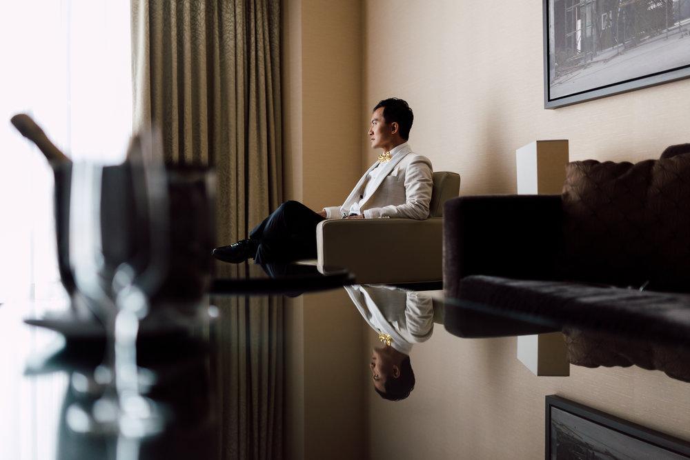 Groom Sitting in chair Shangri-la hotel in toronto Wedding photography