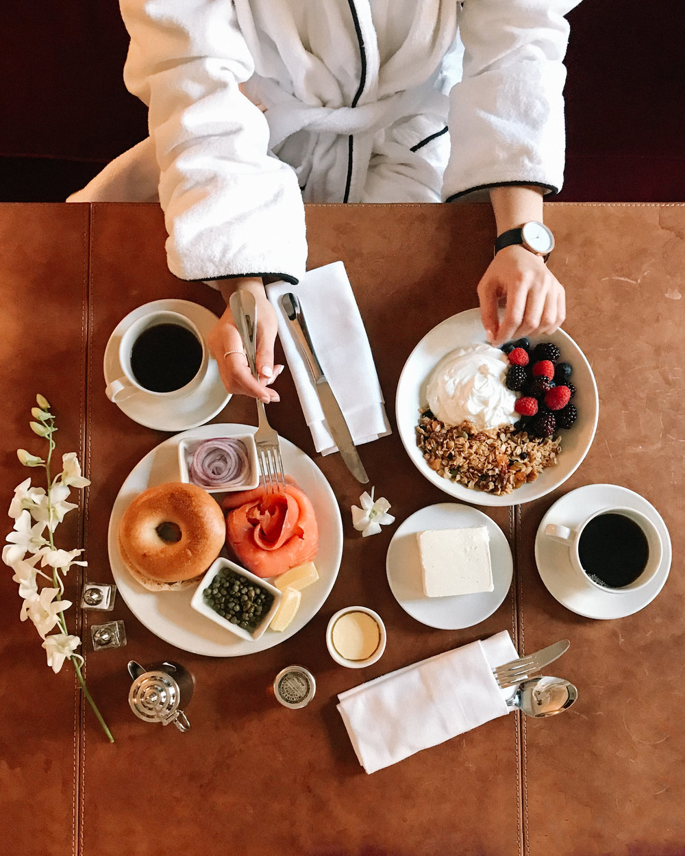 Hotel breakfast on a brown table by a social media photographer