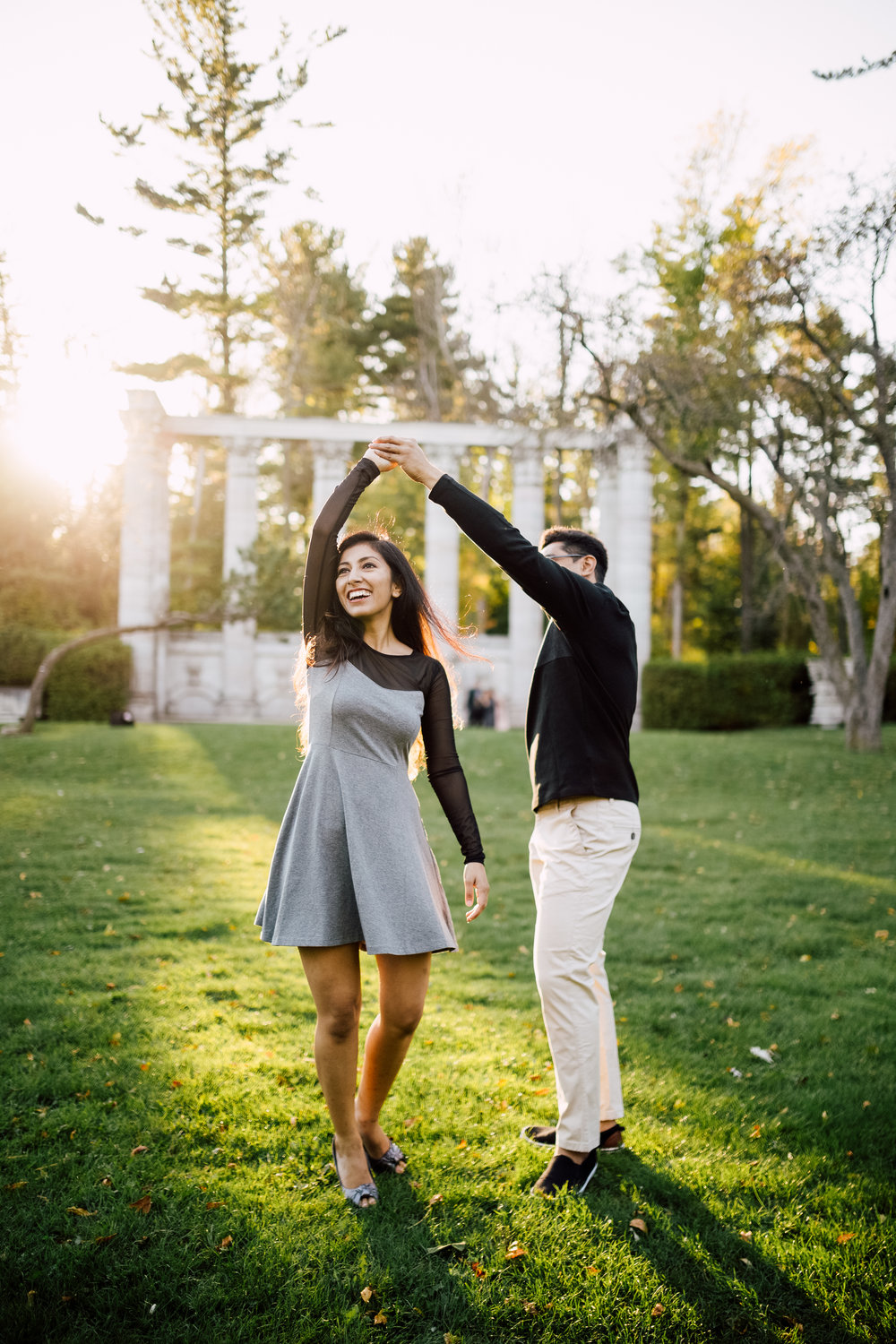 guy spins girl at the guild engagement photography in toronto