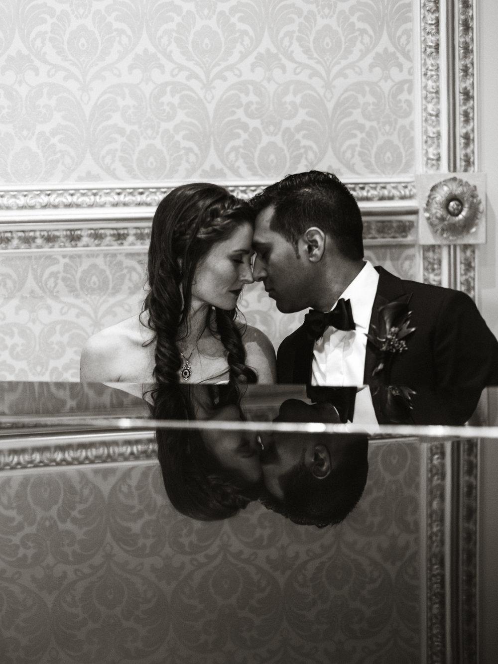 Reflection of couple sitting at a piano at a toronto wedding