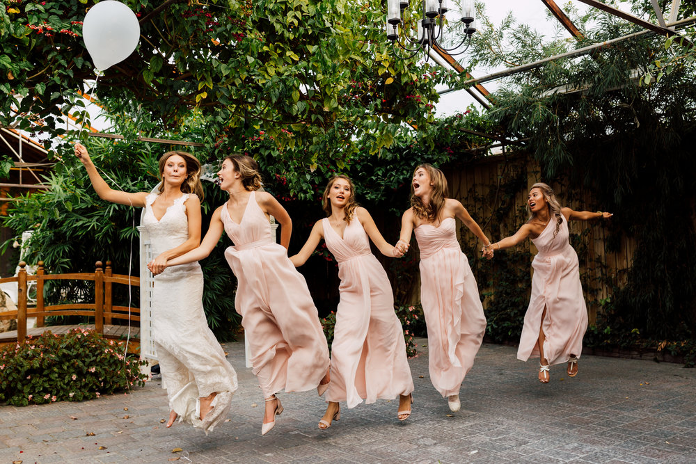 Funny bridal party photography floating by 1 ballon at greenhouse in toronto