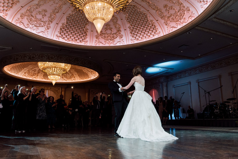 low angle photograph of Couple dancing together at a wedding in toronto