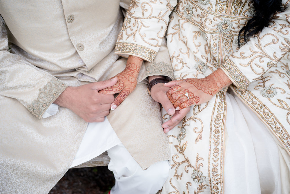Engaged couple holding hands for an indian wedding in toronto
