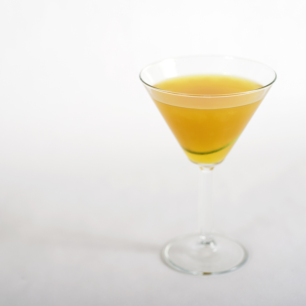 Annie, Get Yr Gun    2 oz  Union Gin  ¾ oz    Pearl Soda Co.     Lime Twist Tea Syrup     1 oz  Lime Juice  1 dropper  Blues Away Bitters from Roots and Crowns Shake and strain into a chilled martini glass Garnish with a twist or slice of lime