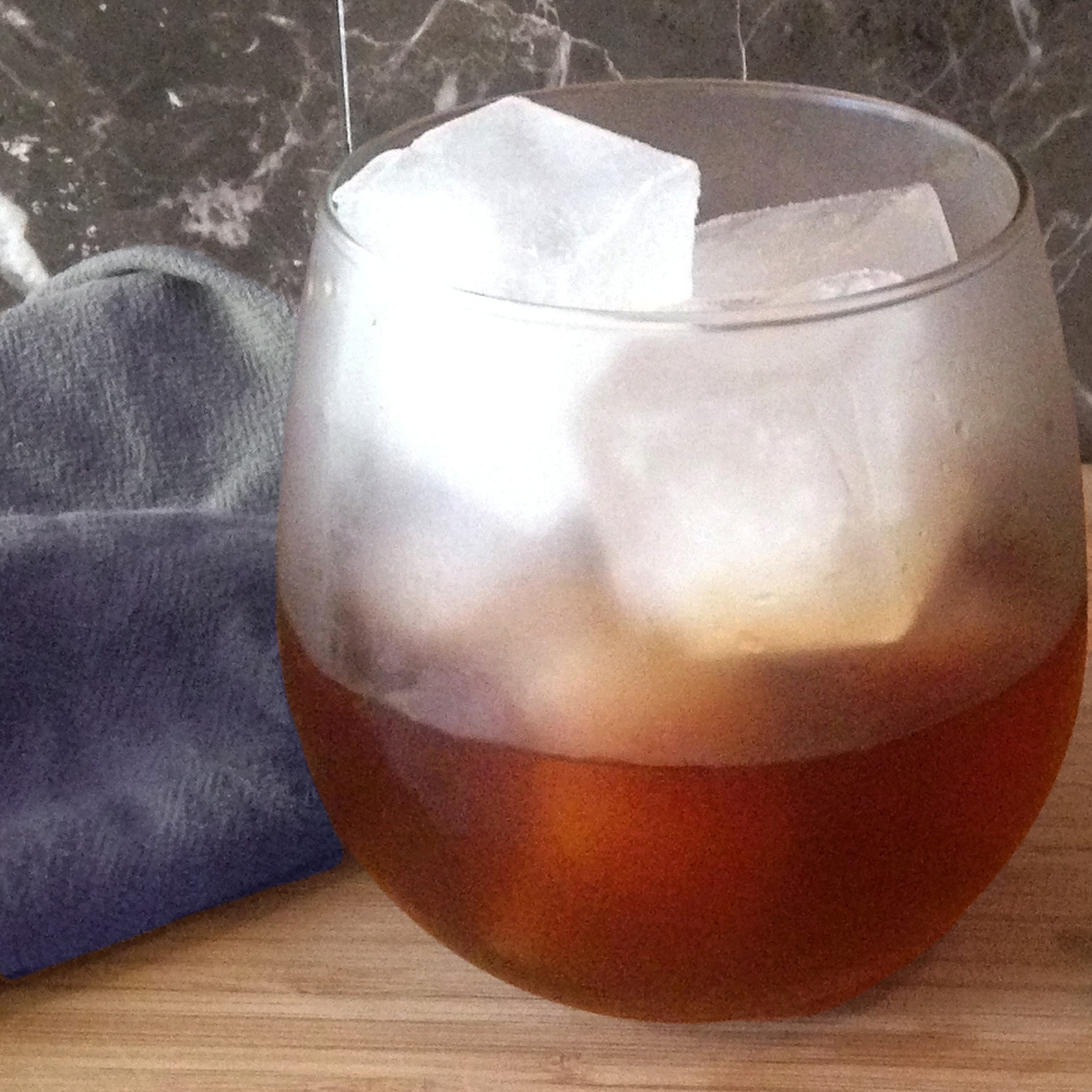 Handsome Gent    2 oz  Cognac  ½ oz  Pearl Soda Co.       Vanilla Rooibos Tea Syrup     1 dropper  Bee Local Bitters from Roots and Crowns Pour over ice into a chilled rocks glass