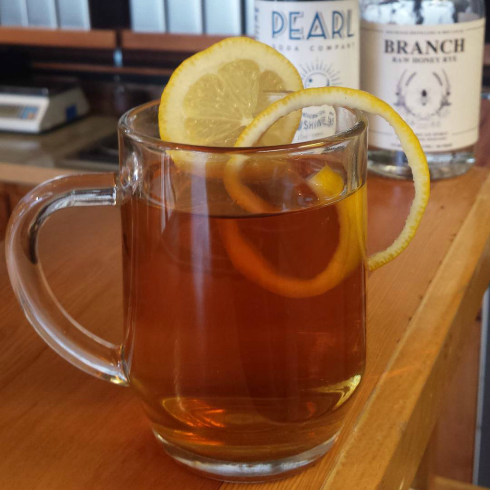 Simplest Toddy    1 oz  Branch Raw Honey Rye  ½ oz    Pearl Soda Co.       Blue Mtn. Sunshine Tea Syrup     4 oz  Hot water Garnish with lemon