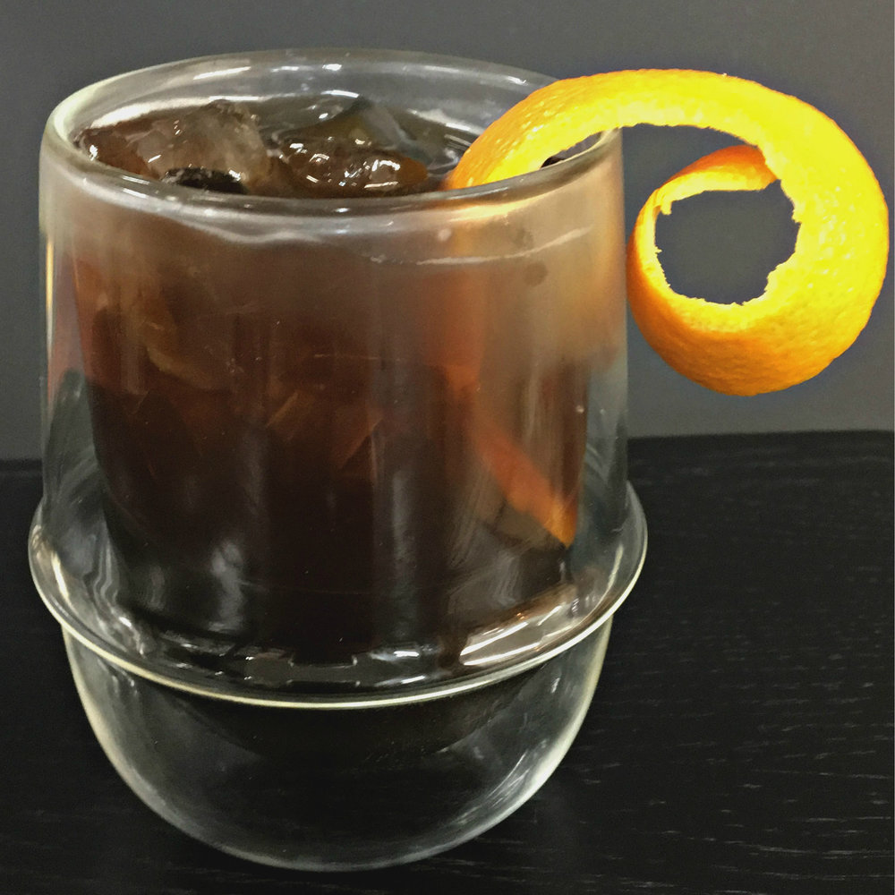 Dragon Heart Strings    1  ½ oz  Aquavit  ½ oz  Pearl Soda Co.     Dancing Dragon Tea Syrup     2 dashes  Pitch Dark Cacao Bitters from Portland Bitters Project Pour over ice into a rocks glass Top with soda water Garnish with a twist of orange