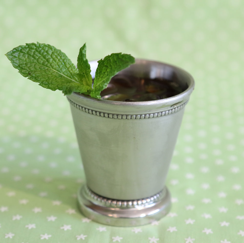 Vanilla Mint Julep    2 oz  bourbon  1 TBSP  brewed  Northwest Mint Tea  from The Jasmine Pearl in 2 oz. water   ½ oz. Pearl Soda Co.  Vanilla Rooibos Tea Syrup    Serve in a julep cup over crushed ice Garnish with fresh mint