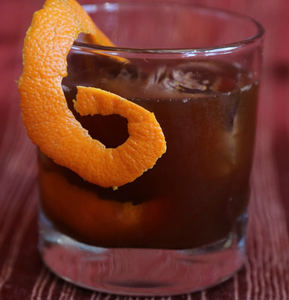 Orange Cardamom Old Fashioned 2 oz Bourbon 1 TBSP brewed Orange Fennel Tea from The Jasmine Pearl ½ oz. Pearl Soda Co. Vanilla Rooibos Tea Syrup 2 oz Bourbon 1 dash Orange Bitters 1 dash Cardamom Bitters Shake and Serve in an old fashioned glass. Garnish with orange peel