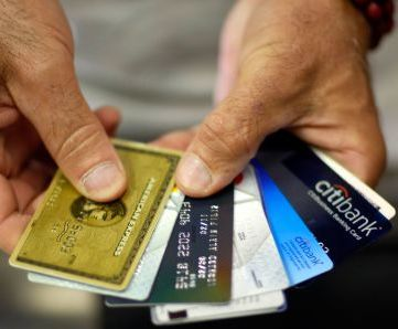 100579567-man-holding-credit-cards-getty.530x298.jpg