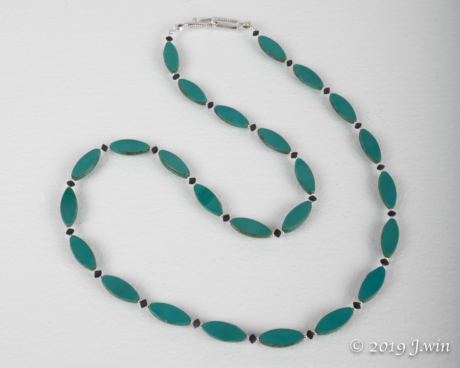 Turquoise pressed glass necklace
