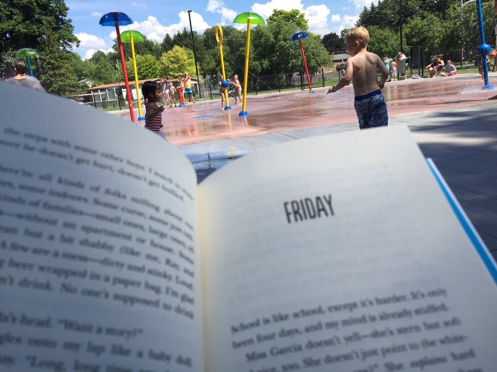 Reading at the splash pad...