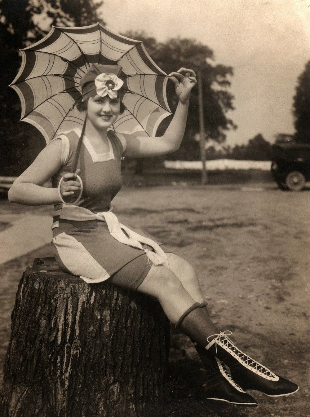 Bathing beauty with umbrella, rolled hose, and hightop shoes. Dayton, Ohio, 1920s.jpg