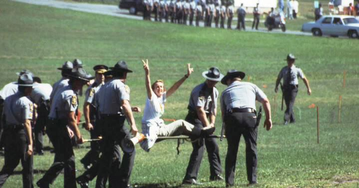 Ingrid arrested at pigeon shoot protest in PA Credit PETA.jpg