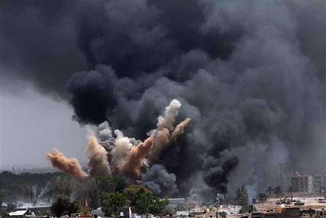 Smoke rises after a NATO airstrike targeting Tripoli, Libya, on June 7, 2011. (credit: EPA)
