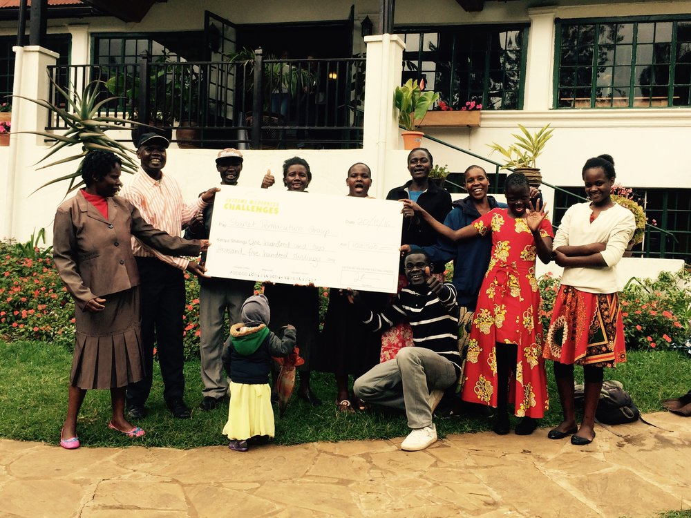 Above: Our Kangemi parent work team holding a cheque for Ksh 100,000/- from a fundraising race . The funds were used to purchase seed, grafted seedlings boleya (manure) and new tools.