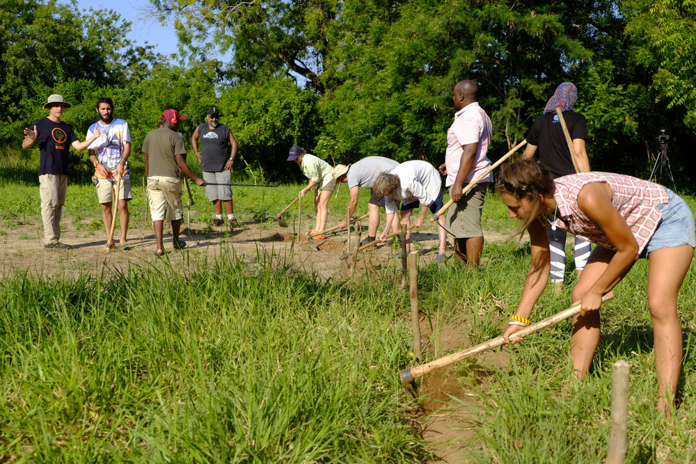 Digging swales on contour | Permaculture Design Course  Photo credit: Karin Duthie | Illustrative Options