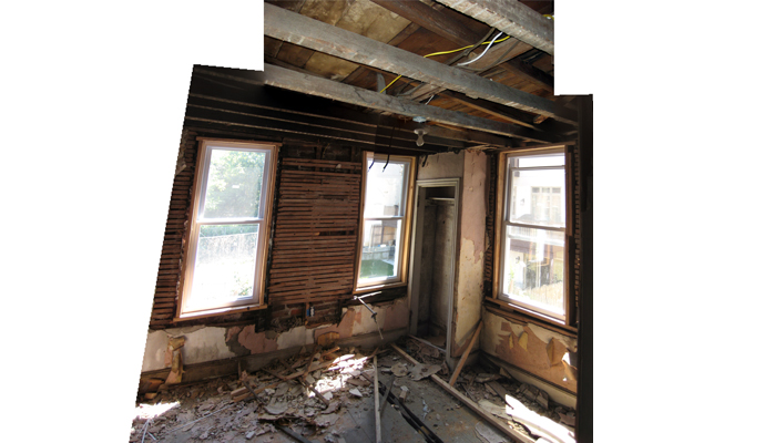 Existing back bedroom; this is typical of the existing interior conditions before renovations started