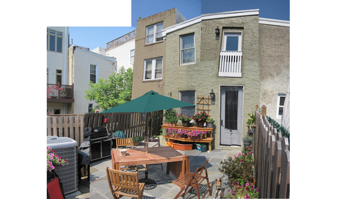The rear patio began as a weed-filled dump for discarded building materials.  The owners have transformed it into an outdoor entertainment space.