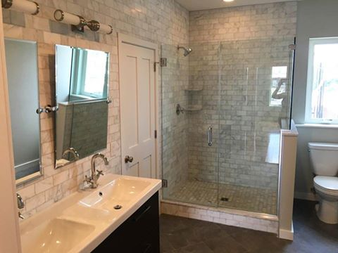 large master bath with double vanity and walk-in shower